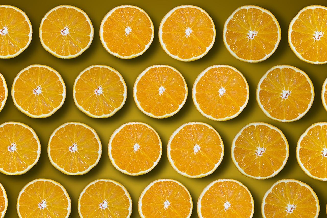 Обои для рабочего стола Текстура окружность Апельсин Оранжевый кусочки Еда Много круг Круги оранжевая оранжевые оранжевых часть Кусок кусочек Пища Продукты питания