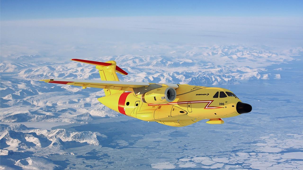 Фото Самолеты Пассажирские Самолеты Embraer, KC-390 Желтый Полет Авиация летящий