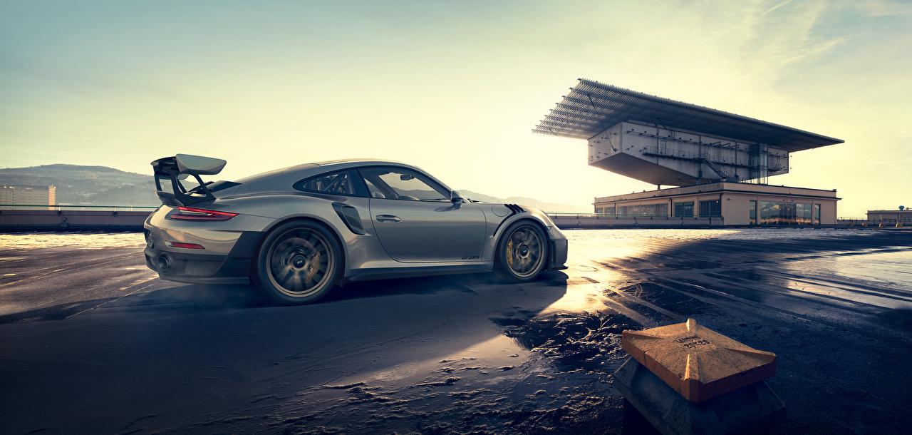 Фотографии Porsche 911 серебристая Сбоку машина Металлик Порше серебряный серебряная Серебристый авто машины автомобиль Автомобили