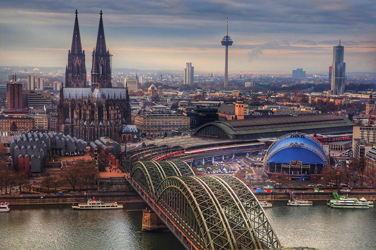 Картинки Кёльн Германия Мосты Реки Причалы Дома Города речка Пирсы Пристань Здания