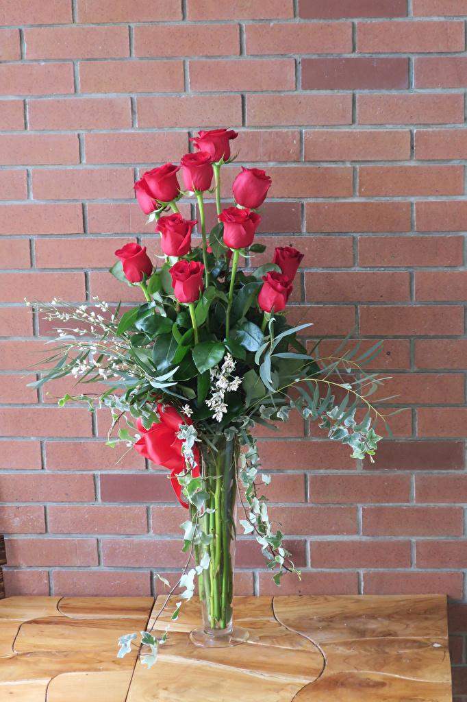 Фотографии букет Розы Красный цветок Стена  для мобильного телефона Букеты роза красная красные красных Цветы стене стены стенка