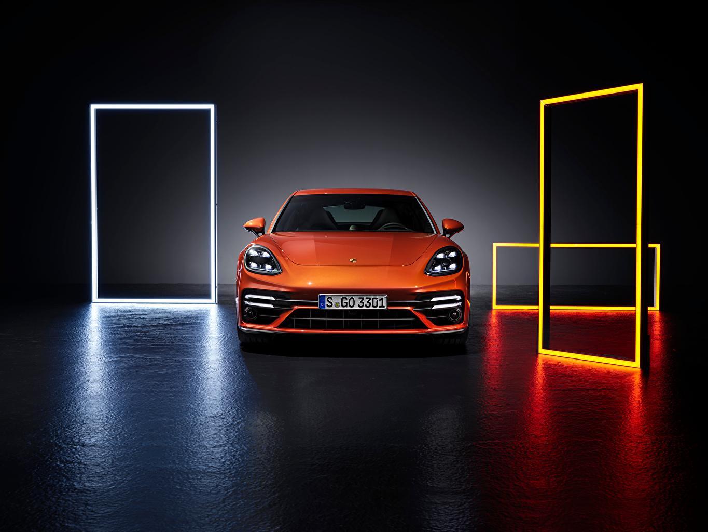 Фотография Porsche Panamera Turbo S (971), 2020 оранжевая машины Спереди Металлик Порше Оранжевый оранжевые оранжевых авто машина Автомобили автомобиль