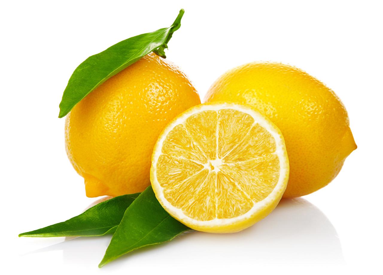 Картинки Лимоны Продукты питания вблизи Белый фон Еда Пища белом фоне белым фоном Крупным планом