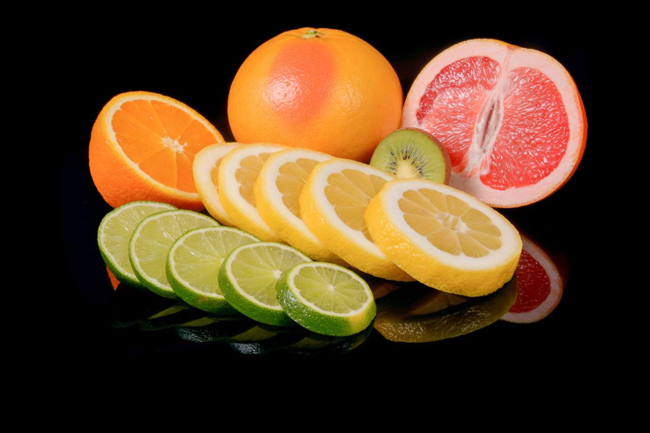 Фото Апельсин Грейпфрут Лимоны Продукты питания Черный фон Цитрусовые Еда Пища