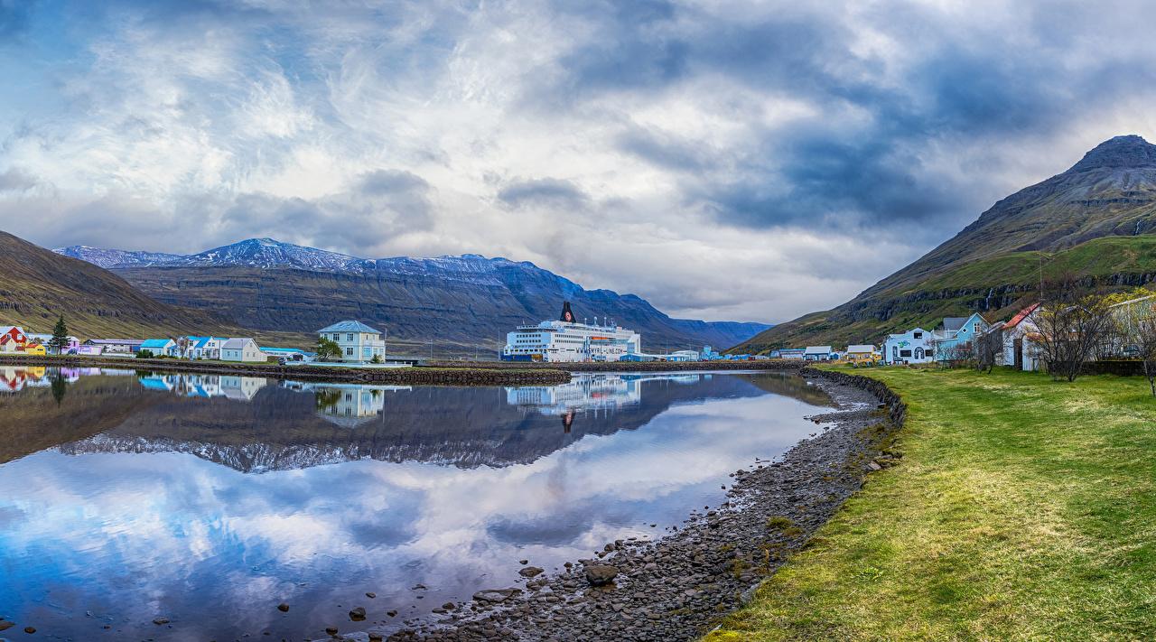 Фото Исландия Горы залива Причалы Дома город гора Пирсы Залив заливы Пристань Здания Города