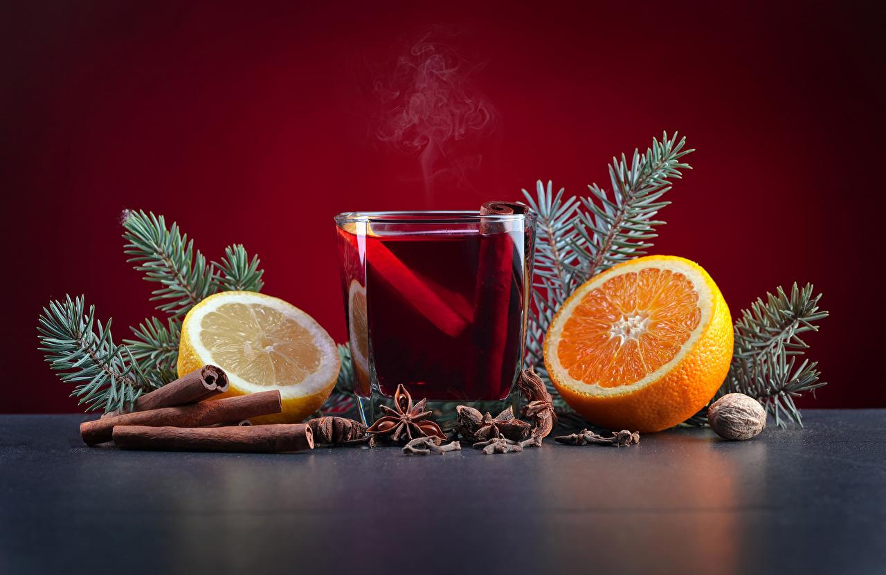 Картинка Новый год Апельсин Бадьян звезда аниса Стакан Лимоны Корица Еда Орехи Напитки Рождество Пища Продукты питания