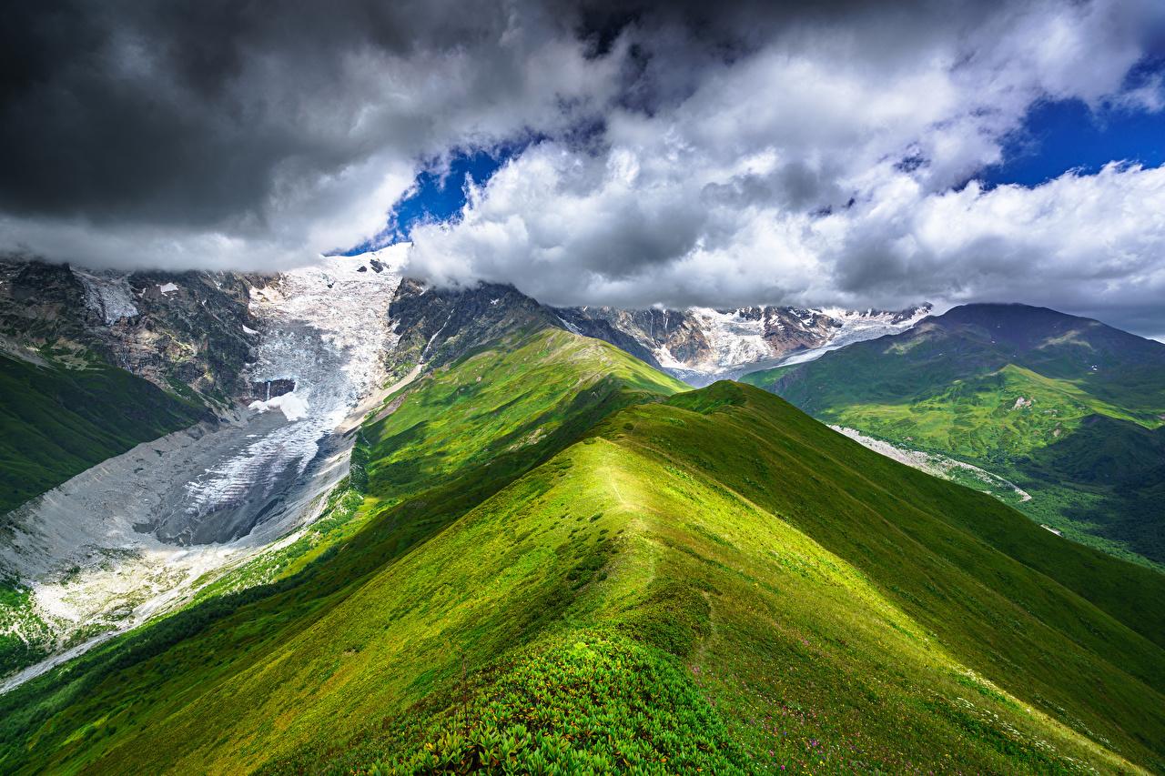 Фото Грузия Chkhutnieri Pass, Upper Svaneti гора Природа Небо снеге Облака Горы Снег снегу снега облако облачно