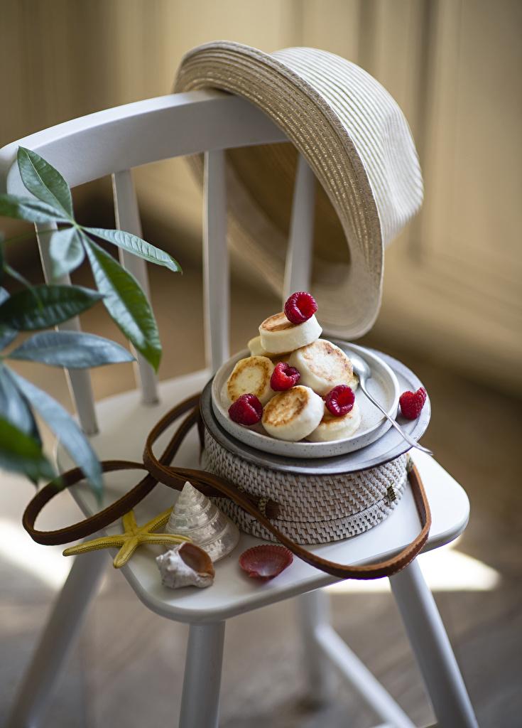 Фотографии Блины шляпы Малина Ракушки Еда Стулья  для мобильного телефона Шляпа шляпе стул Пища Продукты питания