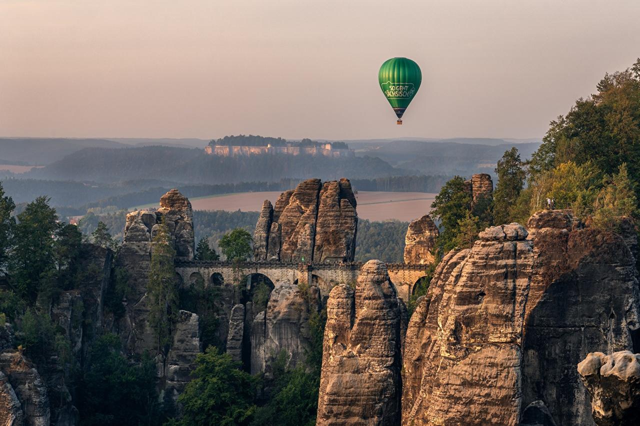 Картинки Германия аэростат Elbsandsteingebirge, Sächsische Schweiz Утес Мосты Природа Воздушный шар мост скалы Скала скале