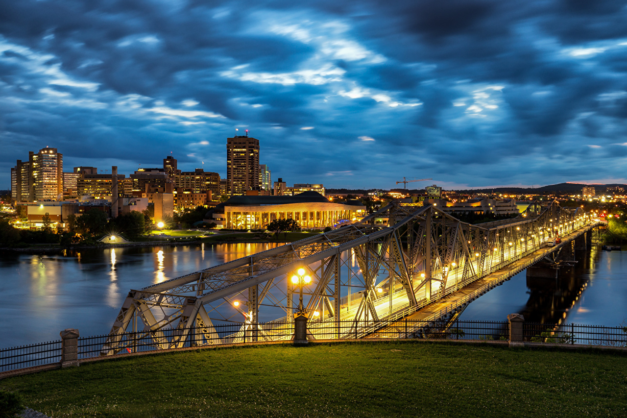 Фото Канада Ottawa River, Alexandra Bridge мост Реки Вечер город Здания Мосты река речка Дома Города