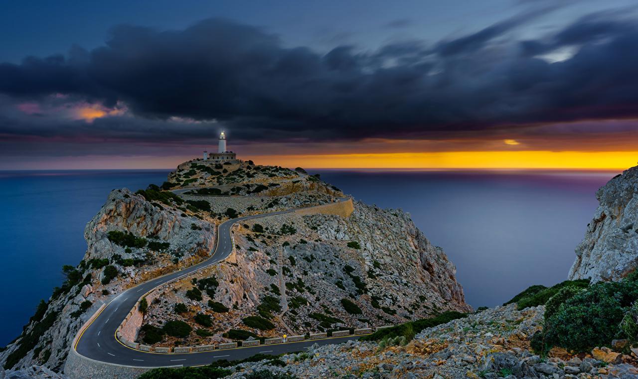 Фото Мальорка Майорка Испания Sonnenaufgang Море маяк Природа Дороги Вечер Маяки