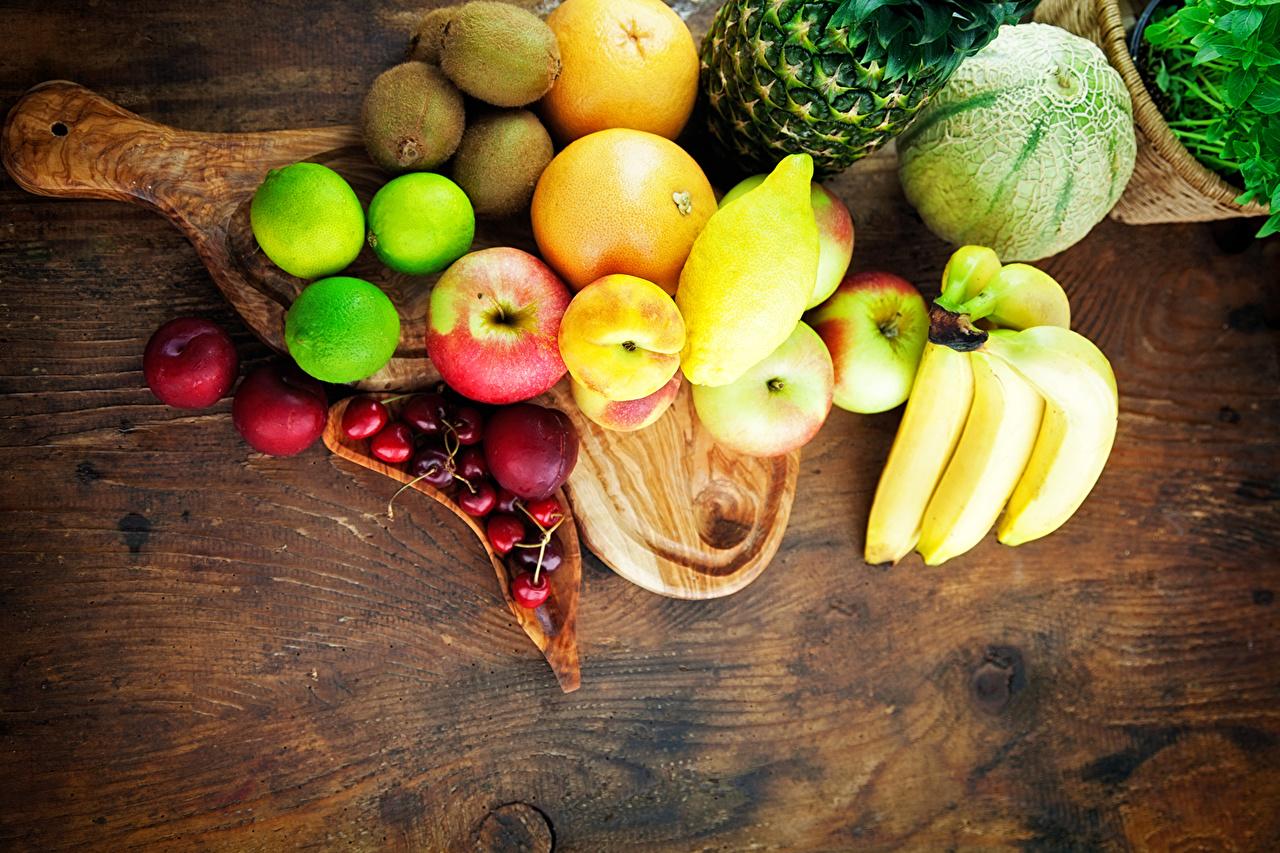 Фотографии Апельсин Дыни Яблоки Бананы Лимоны Фрукты Продукты питания Еда Пища
