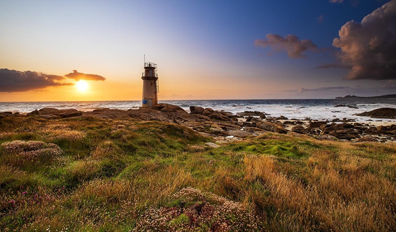 Картинки Испания Galicia маяк солнца Природа рассвет и закат берег Маяки Солнце Рассветы и закаты Побережье