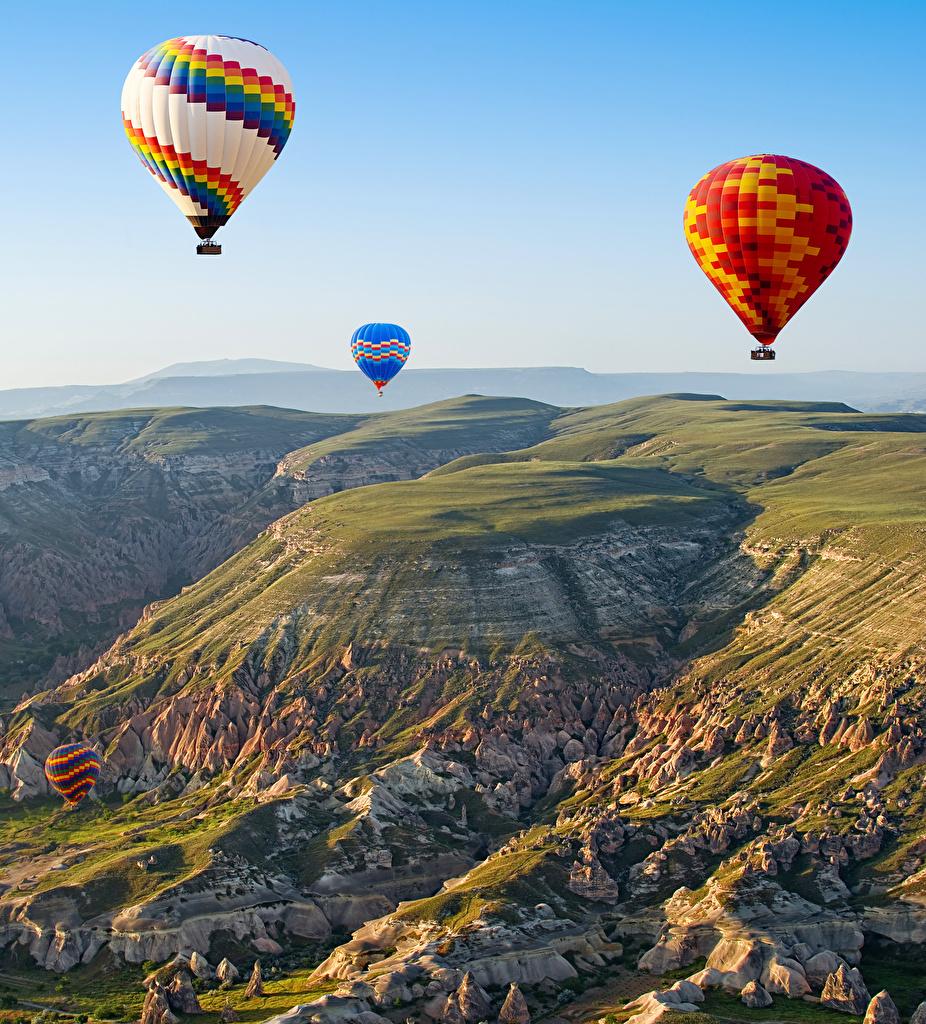 Фотографии Турция Воздушный шар Cappadocia Горы Природа Небо Аэростат