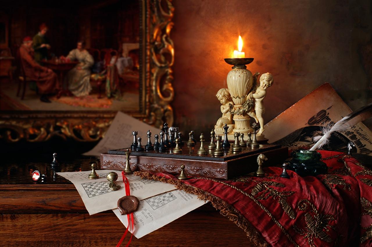 Фото Шахматы пламя Перья Свечи Натюрморт Огонь