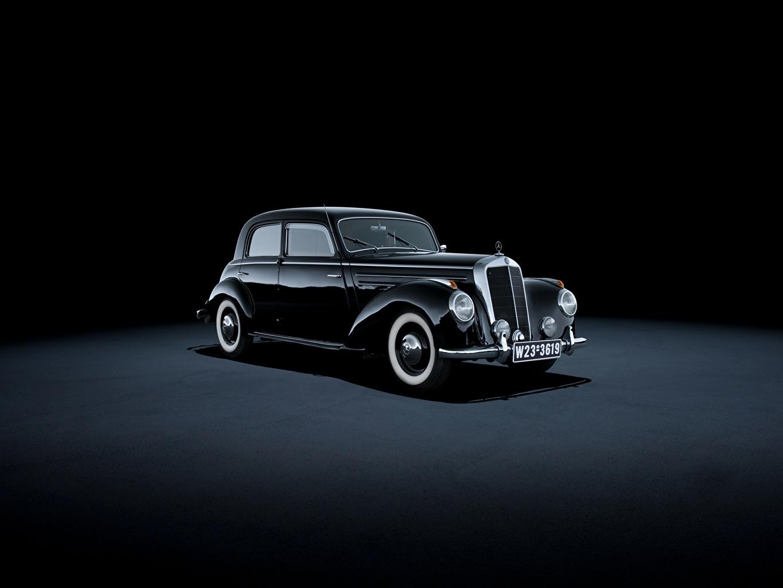 Фото Мерседес бенц 1951-55 220 Limousine черных старинные машина Металлик сером фоне Mercedes-Benz Ретро Черный черные черная Винтаж авто машины автомобиль Автомобили Серый фон