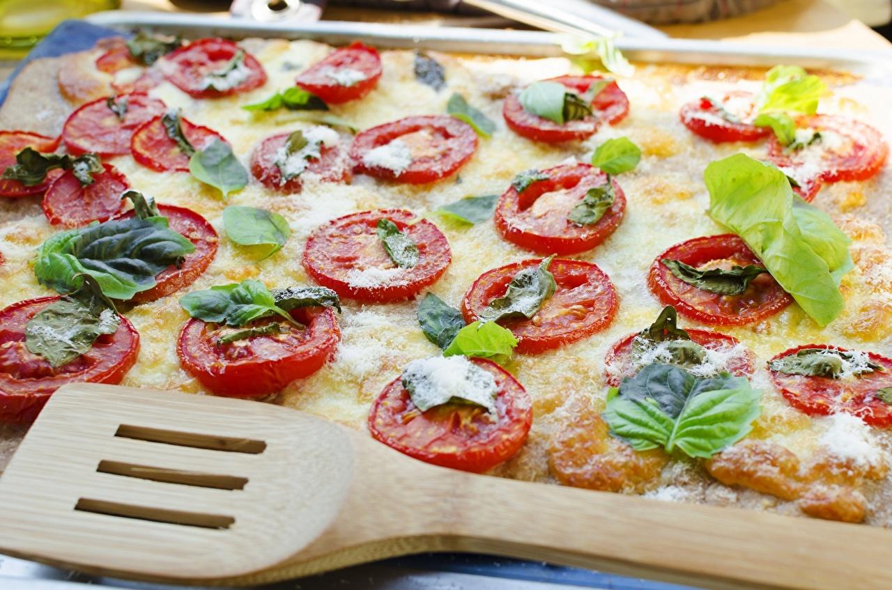 Фото Пицца Томаты Пища Выпечка Крупным планом Помидоры Еда Продукты питания вблизи