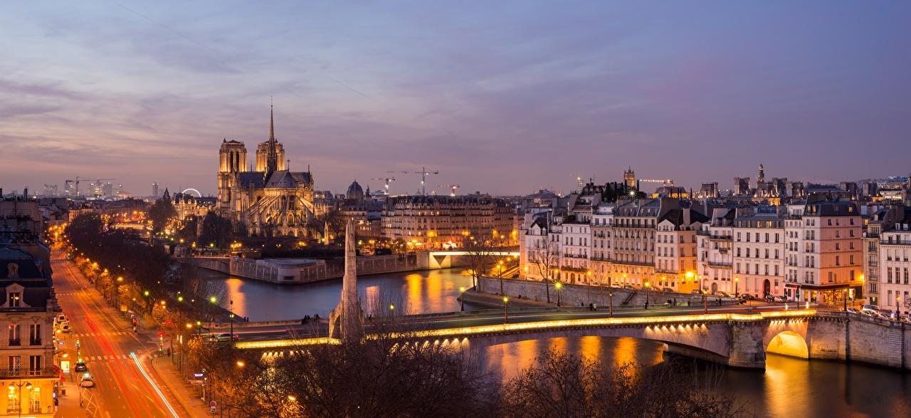 Обои для рабочего стола Париж Франция Мосты Реки Вечер Дома Города париже мост река речка город Здания