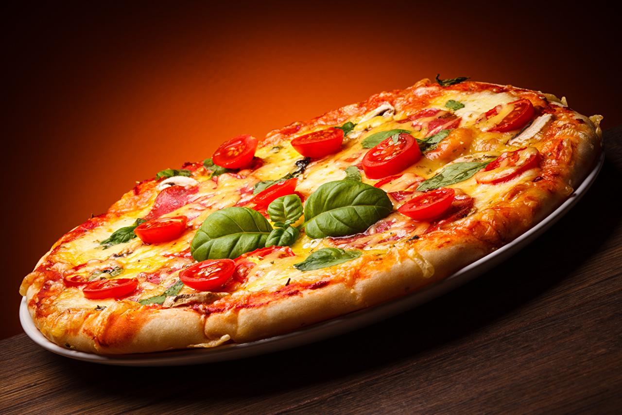 Фотография Еда лист Пицца Помидоры Быстрое питание Базилик душистый Пища Продукты питания Листва Листья Томаты Фастфуд
