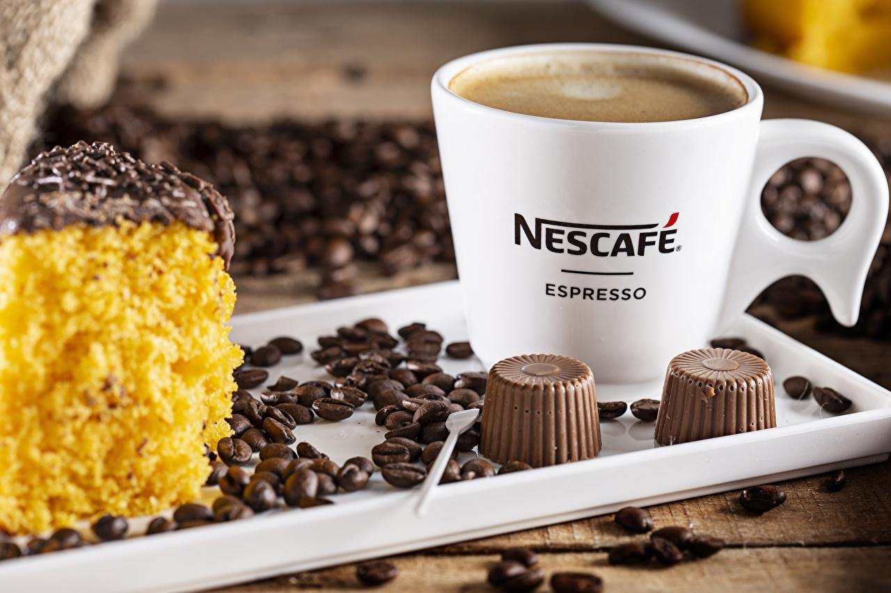 Обои для рабочего стола Nescafe Кофе Конфеты зерно кружке Продукты питания Зерна Еда Пища кружки Кружка