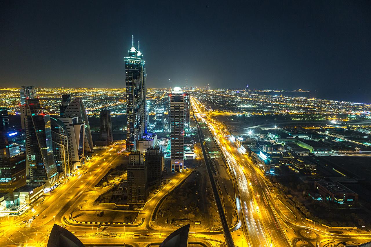 Фото Дубай Объединённые Арабские Эмираты Мегаполис Дороги Ночь Небоскребы Города ОАЭ Ночные