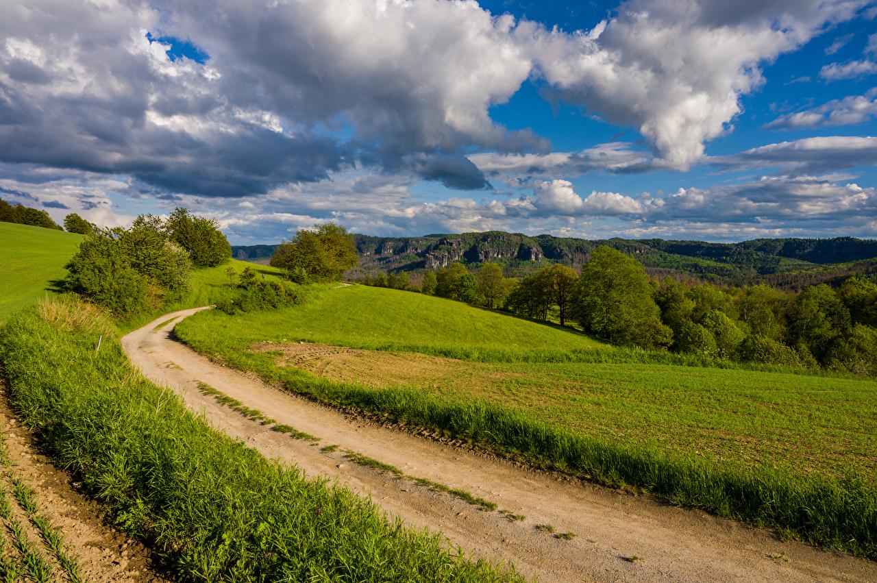 Картинка Германия Saxony Природа Поля Дороги Пейзаж облако Облака облачно