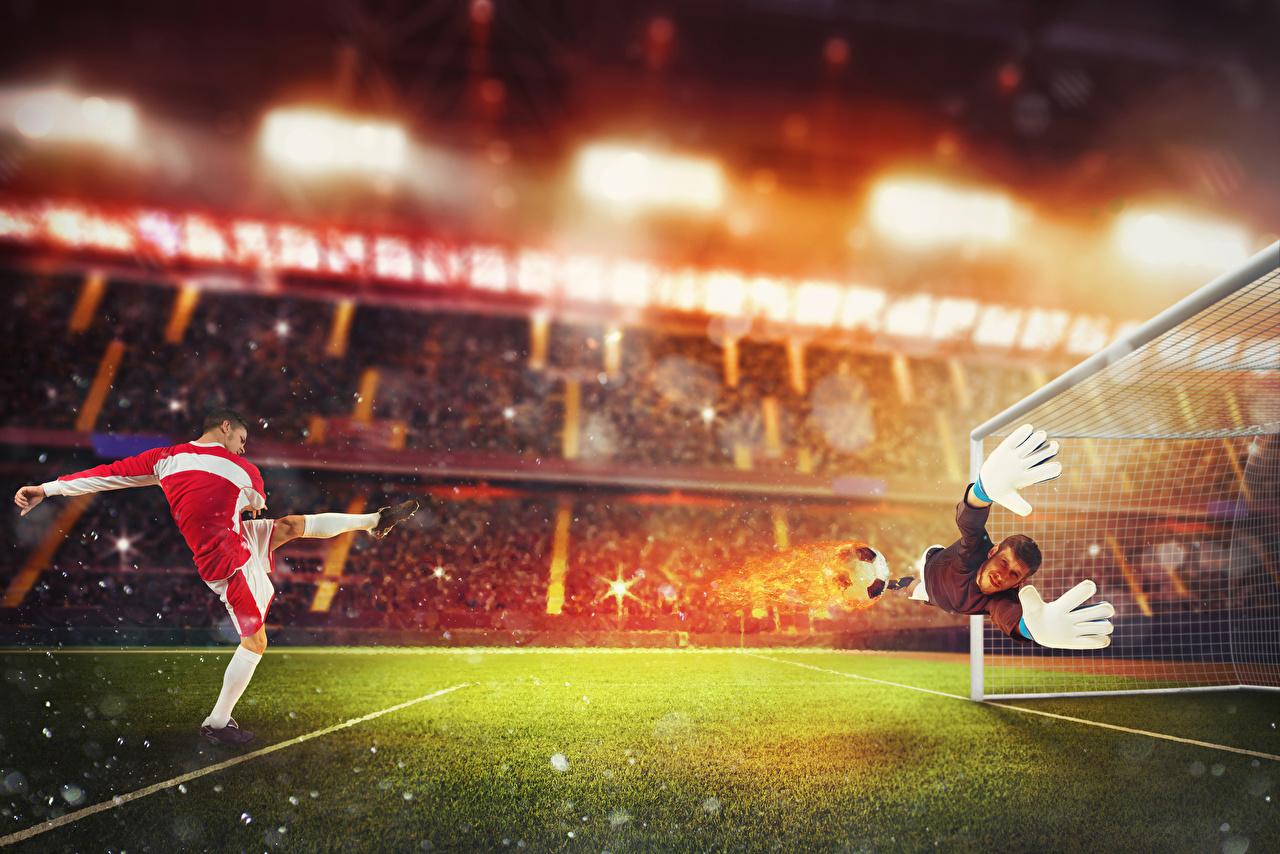 Фото Мужчины Вратарь в футболе Спорт Футбол прыгать Руки газоне униформе спортивный спортивная спортивные Прыжок прыгает в прыжке рука Газон Униформа