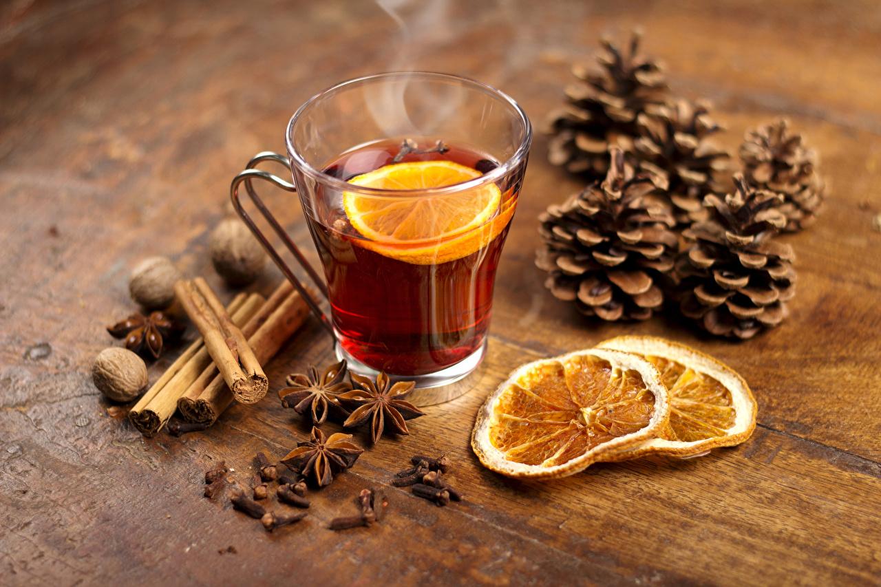 Фото Новый год Чай Бадьян звезда аниса Корица Лимоны Чашка Шишки Продукты питания Орехи Рождество Еда Пища