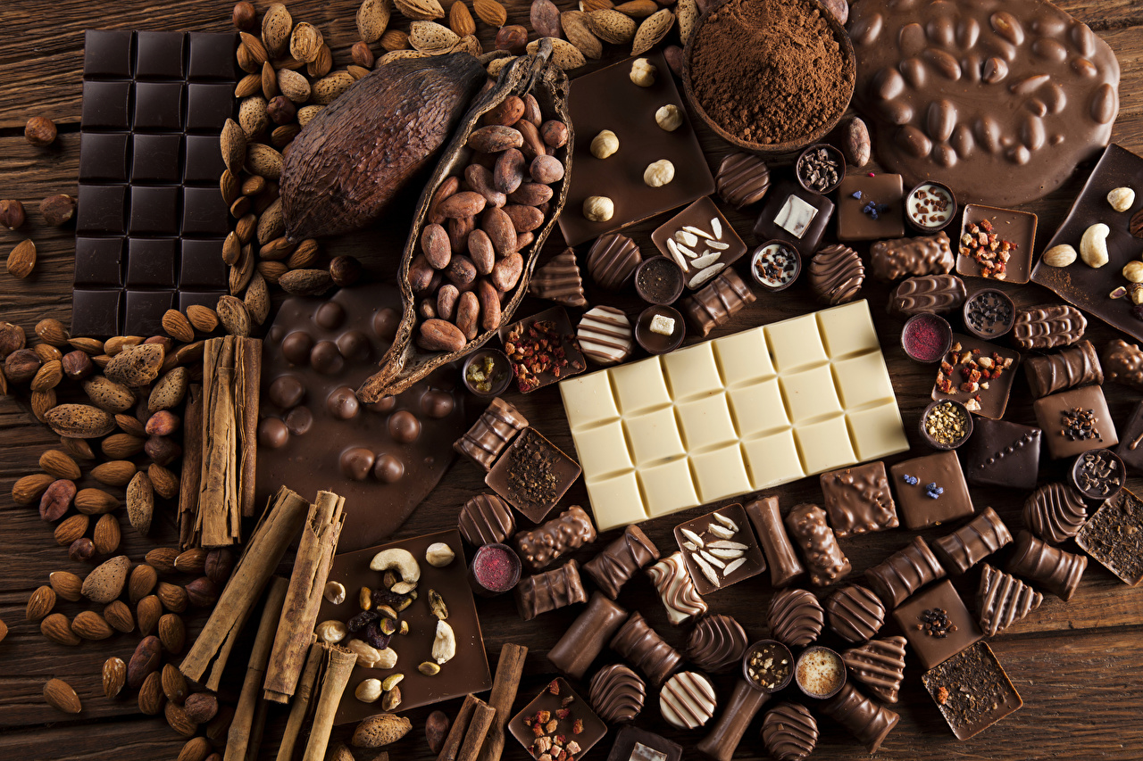 Картинки Еда Шоколад Конфеты Корица шоколадка Орехи Сладости Пища Продукты питания Шоколадная плитка