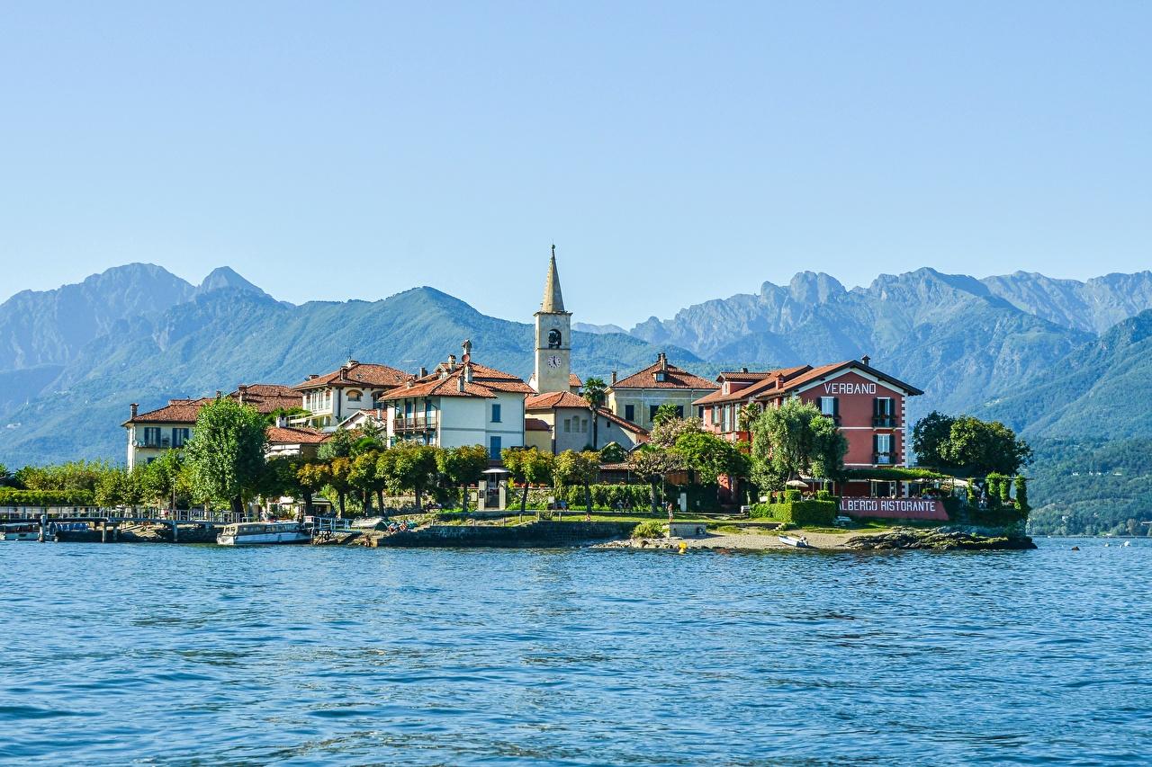 Фото альп Италия Lake Maggiore, Pescatori Island Горы Природа Озеро Остров Здания Альпы гора Дома