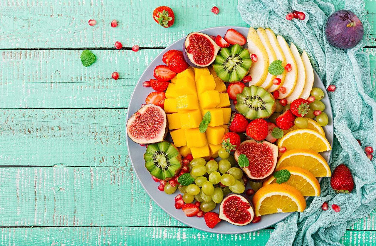 Фотография Манго Инжир Апельсин Киви Фрукты Продукты питания Еда Пища