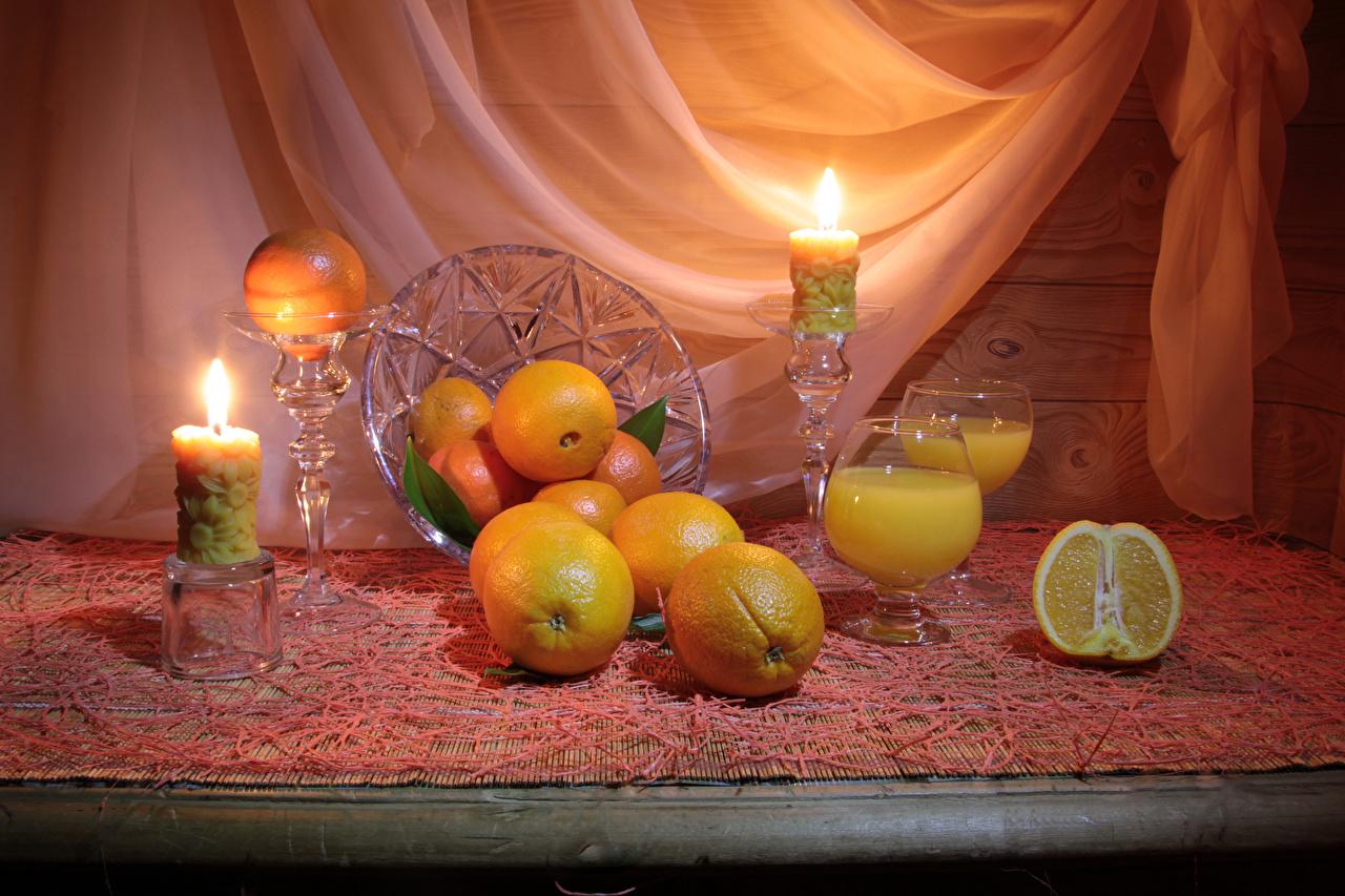 Фотографии Апельсин Еда Свечи Натюрморт Цитрусовые Пища Продукты питания