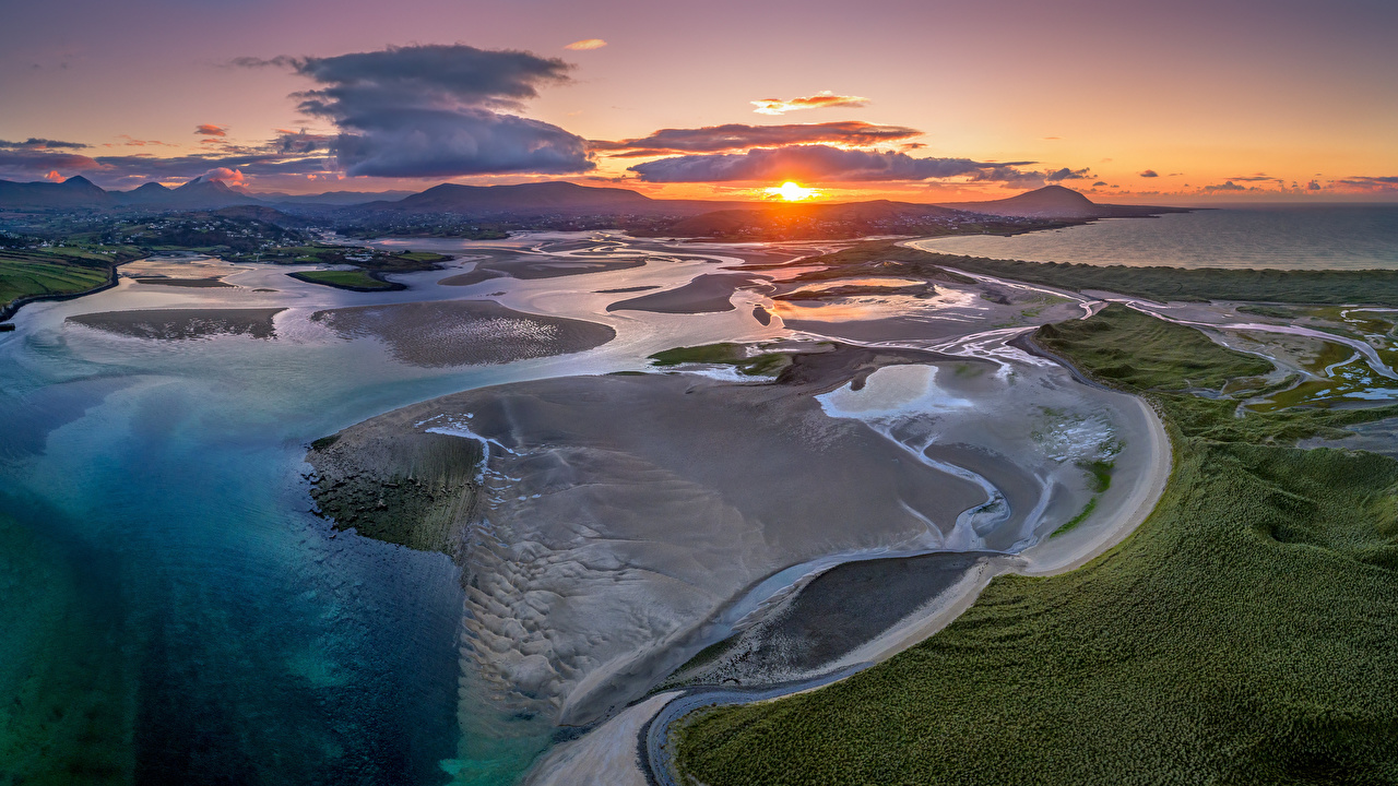 Фотография Ирландия Donegal Солнце Природа рассвет и закат берег Сверху облако солнца Рассветы и закаты Побережье Облака облачно