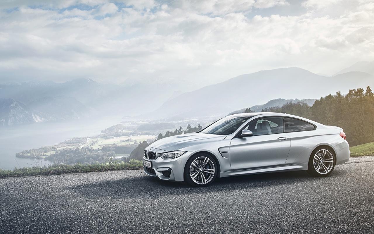 Фотографии BMW авто Сбоку асфальта облачно БМВ машины машина Асфальт Автомобили автомобиль Облака облако