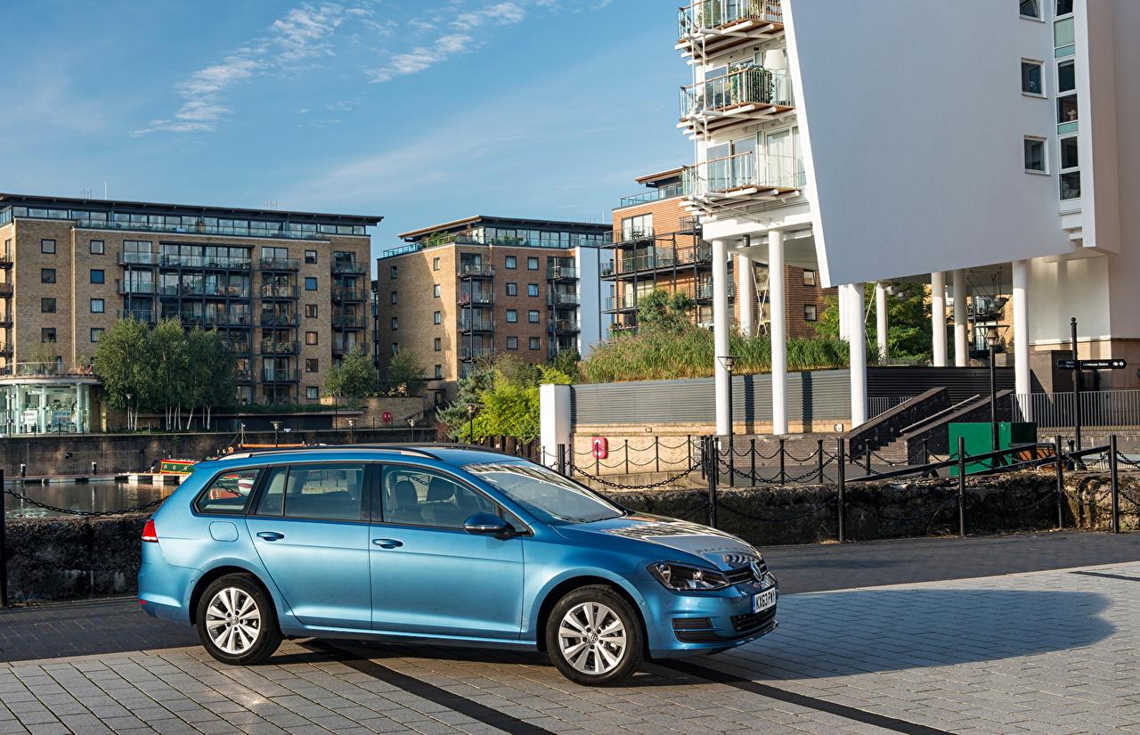 Фото Фольксваген 2013 Golf VII Estate Голубой Сбоку автомобиль город Volkswagen голубая голубые голубых авто машины машина Автомобили Города