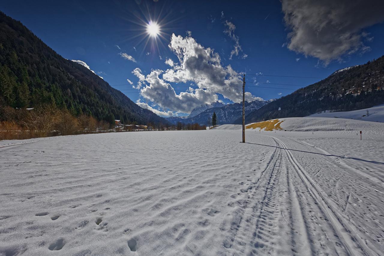 Картинка Австрия Tyrol гора зимние Солнце Природа снегу облачно Зима Горы солнца Снег снеге снега облако Облака