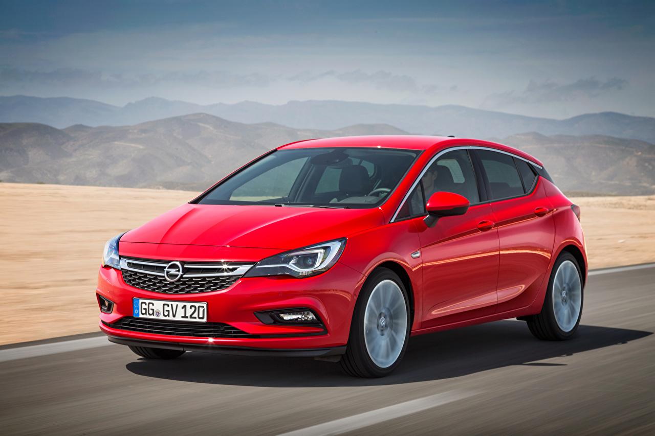Обои для рабочего стола Opel Astra, 2015 Красный едет Металлик автомобиль Опель красная красные красных едущий едущая скорость Движение авто машины машина Автомобили