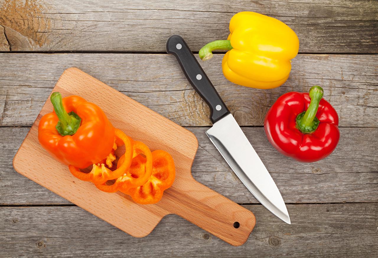 Картинки Нож Пища Перец Разделочная доска Доски ножик Еда Продукты питания