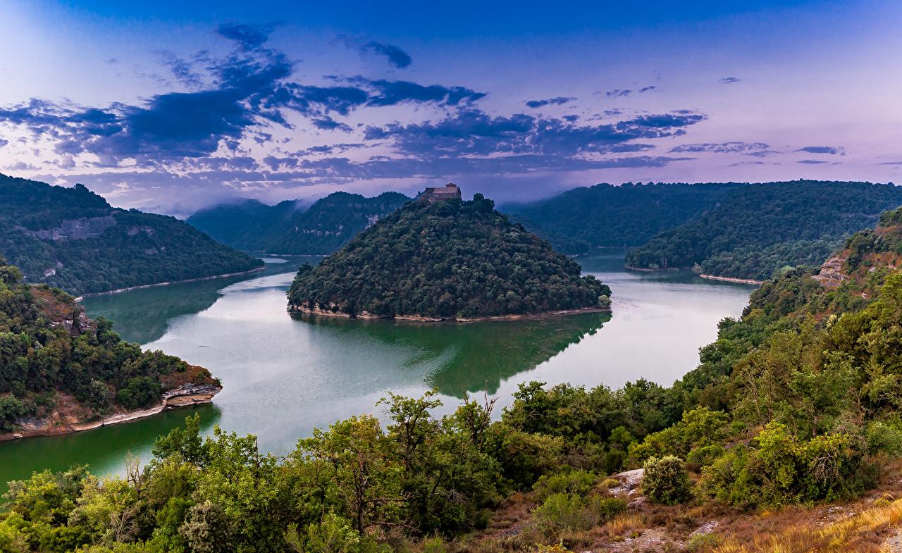 Картинки Монастырь Испания Sant Pere de Casserres Catalonia скале Природа Остров речка дерево Утес Скала скалы Реки река дерева Деревья деревьев
