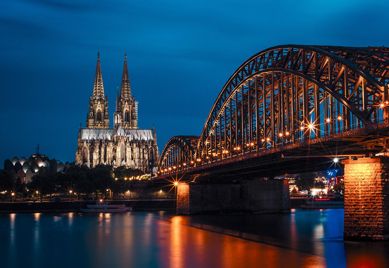 Фотография Германия Cologne Мосты Ночь Храмы Пирсы речка Уличные фонари Города мост храм река Реки ночью в ночи Ночные Причалы Пристань город