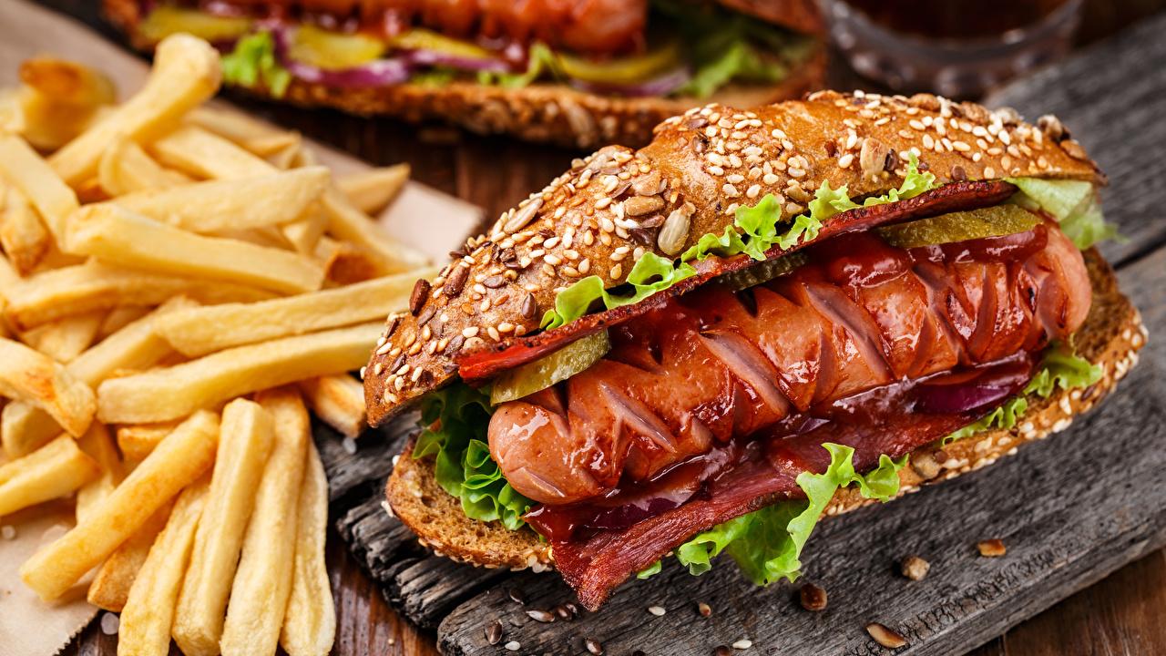Фотография Хот-дог Картофель фри Сосиска Булочки Быстрое питание Продукты питания Фастфуд Еда Пища