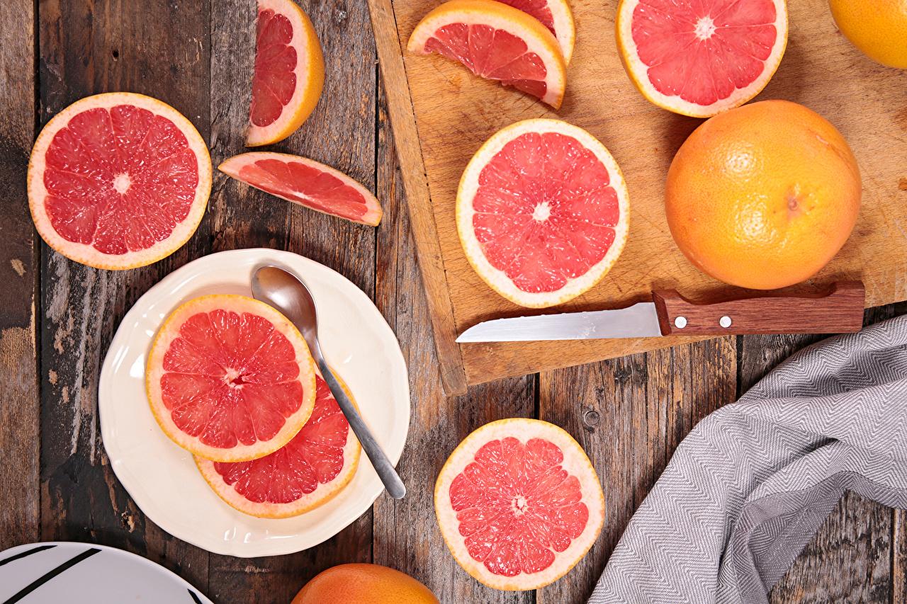 Фотография Нож Грейпфрут Еда нарезка тарелке Цитрусовые ножик Пища Тарелка Продукты питания Нарезанные продукты