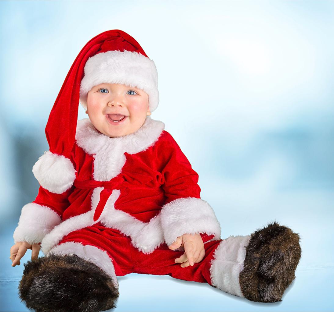 Фотографии младенца Рождество улыбается ребёнок шапка Униформа Младенцы младенец грудной ребёнок Новый год Улыбка Дети Шапки в шапке униформе