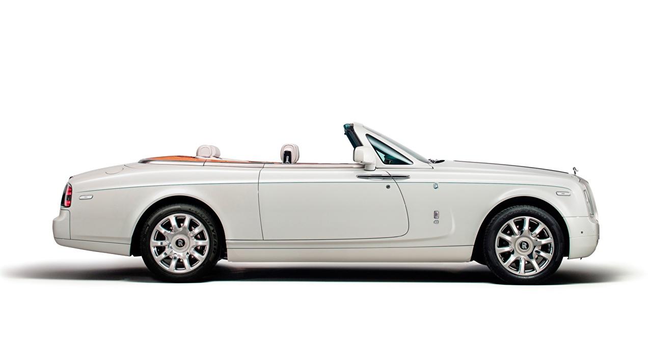Картинки Rolls-Royce Phantom Drophead, Coupe Maharaja, 2014 роскошная кабриолета белая Сбоку автомобиль Белый фон Роллс ройс дорогие дорогая дорогой люксовые Кабриолет роскошный Роскошные Белый белые белых авто машины машина Автомобили белом фоне белым фоном