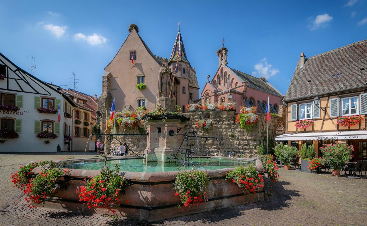 Картинка Франция Фонтаны Городская площадь Eguisheim Здания Города Скульптуры городской площади Дома город скульптура