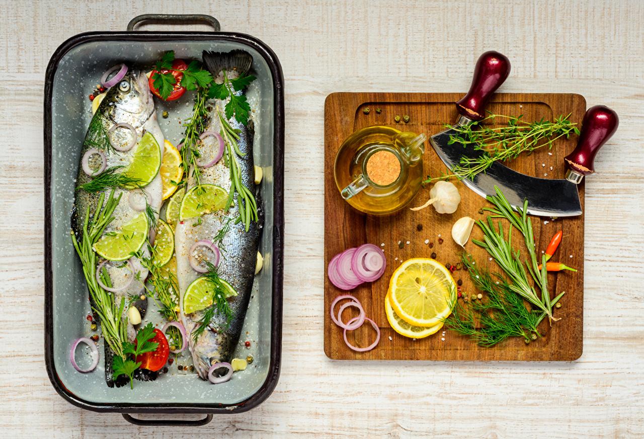 Картинка Рыба Укроп Чеснок Лимоны приправы Продукты питания разделочной доске Еда Пища Специи пряности Разделочная доска