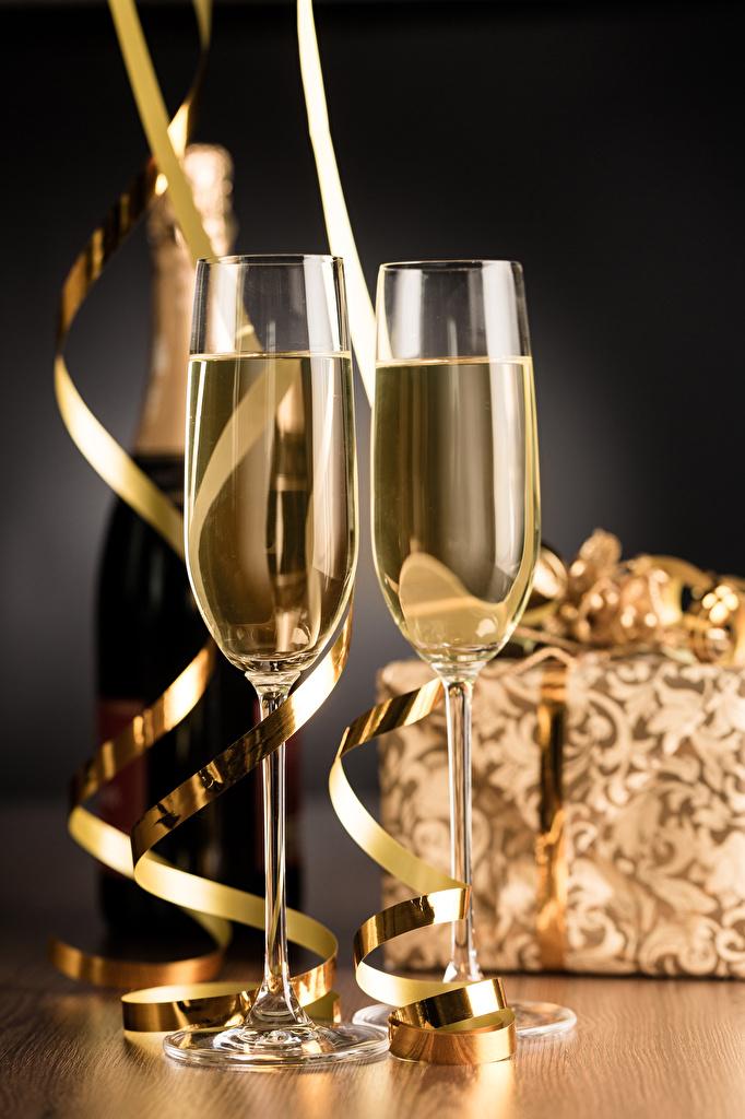 Фотографии Рождество Игристое вино Еда Бокалы бутылки Новый год Шампанское Пища бокал Бутылка Продукты питания