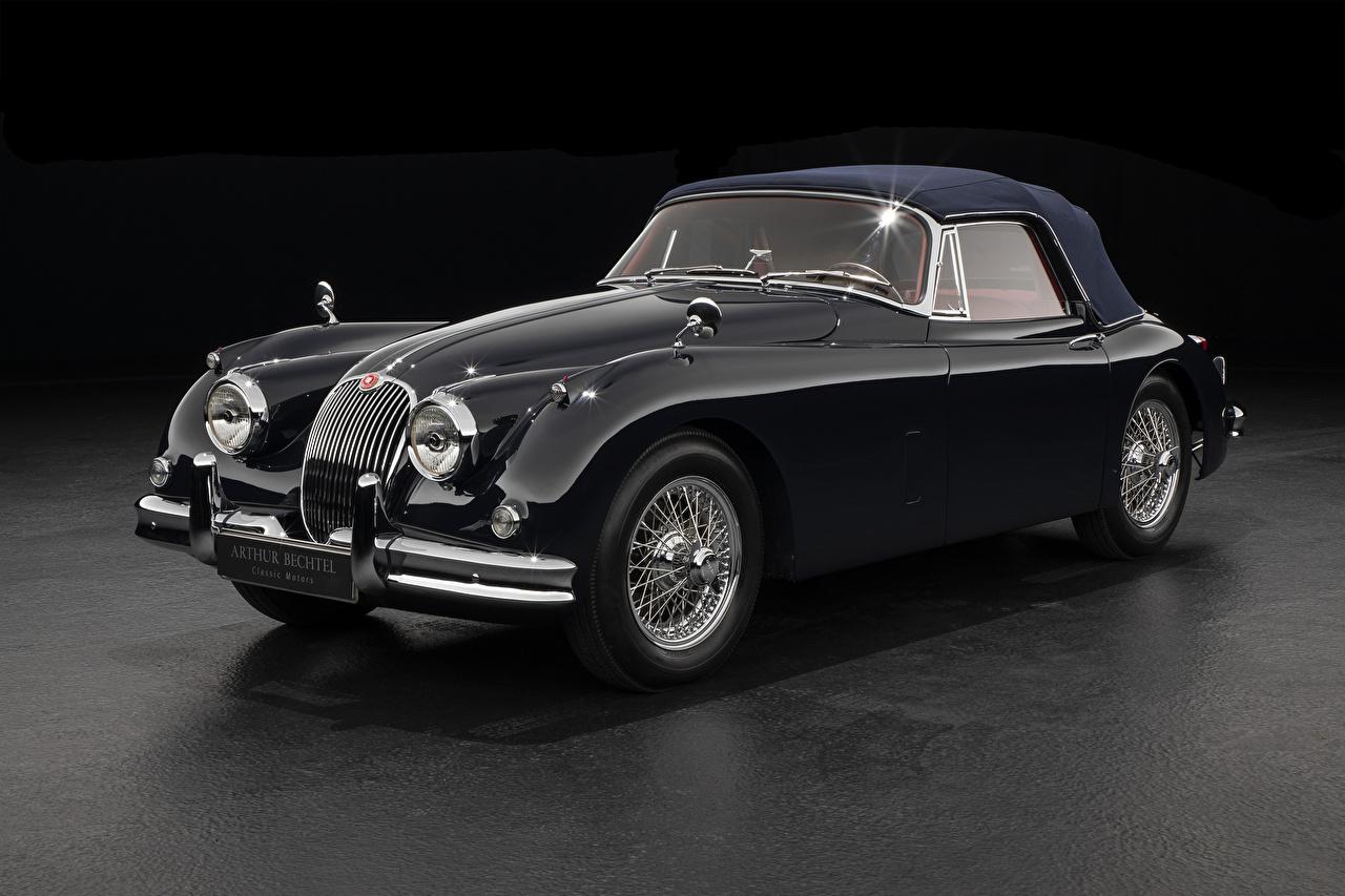 Фотографии Ягуар 1958-61 XK150 Drophead Coupe Купе Ретро Черный Металлик автомобиль Серый фон Jaguar черных черные черная Винтаж старинные авто машина машины Автомобили сером фоне