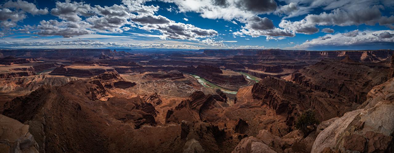 Картинки штаты Панорама Canyonlands National Park, Utah скалы Каньон Природа Небо Парки Пейзаж США америка панорамная Утес скале Скала каньона каньоны парк