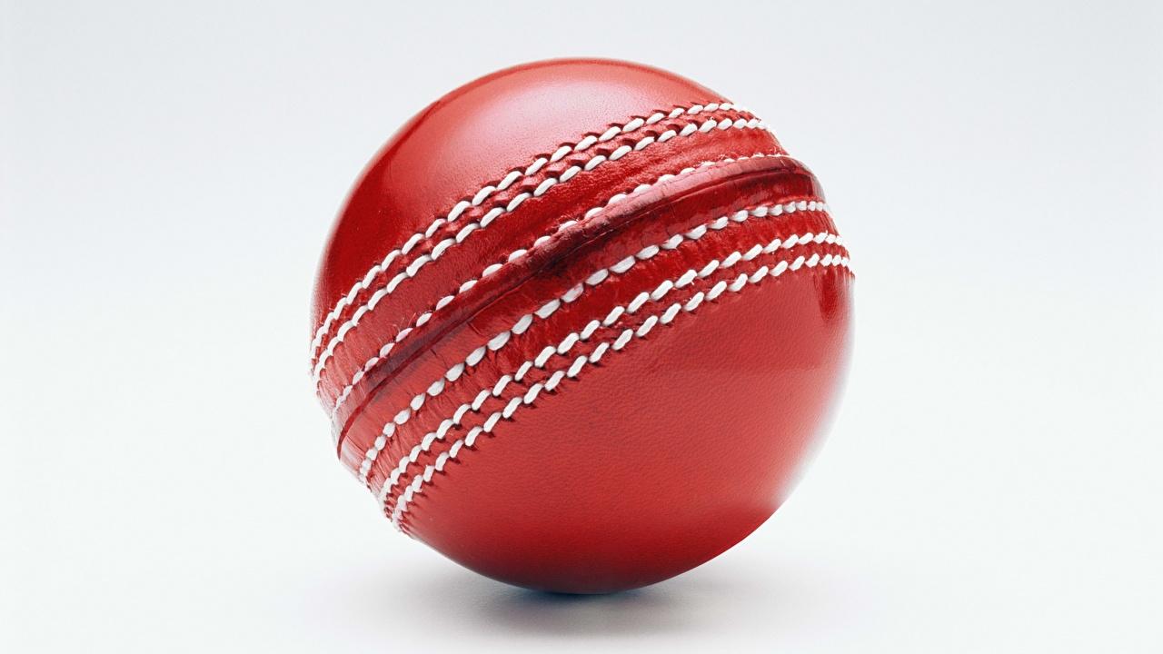 Картинка Cricket Спорт Красный Мяч Серый фон Крупным планом вблизи